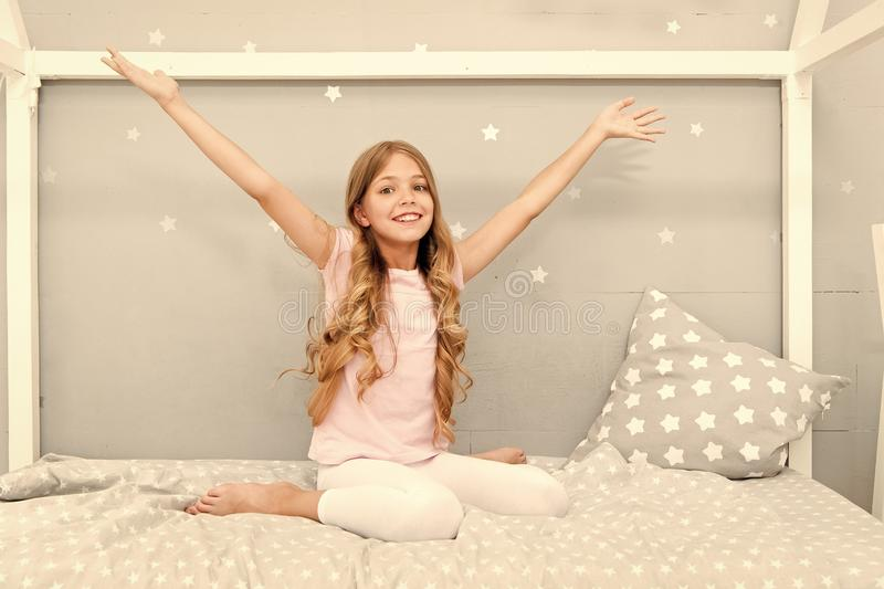 Good morning. Girl child long curly hair awake. Pleasant awakening. Girl looks cheerfully and full of energy in morning. Tips having pleasant morning every day royalty free stock photography