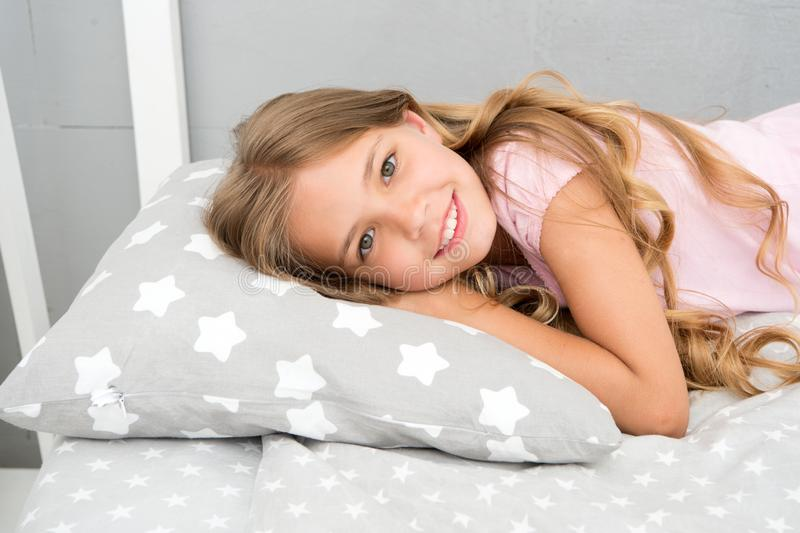 Good morning. Girl child long hair lay awake close up. Quality of sleep depends on many factors. Choose proper pillow to. Sleep well. Girl on little pillow royalty free stock photography