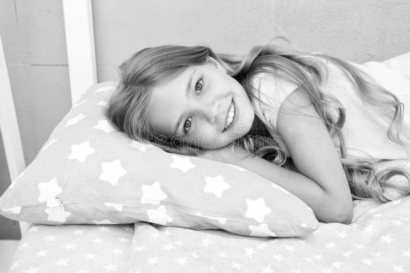 Good morning. Girl child long hair lay awake close up. Quality of sleep depends on many factors. Choose proper pillow to. Sleep well. Girl on little pillow stock images