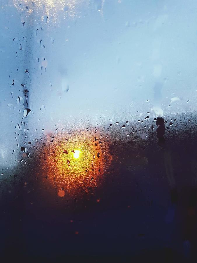 Good morning, guys. It's cold outside. Window, rain, artsy, light, trafficlight, its stock images