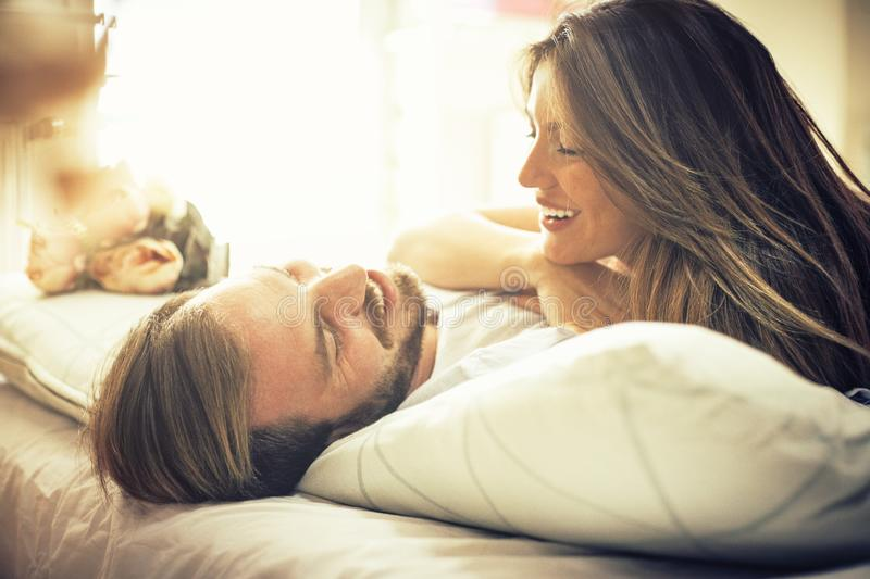 Good morning handsome. Happy young couple in bed. Space for copy royalty free stock images