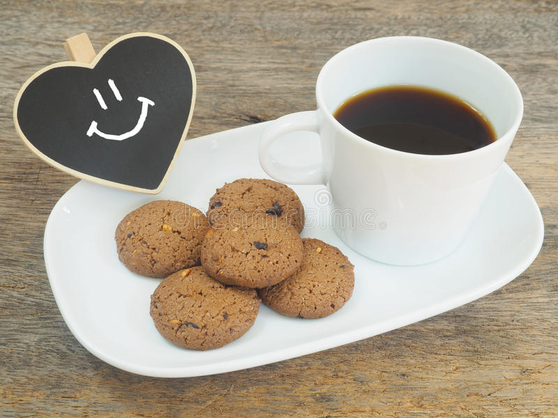 Good morning or Have a nice day concept. White cup of coffee and cookies.Good morning or Have a nice day concept.vintage filter effect stock photo