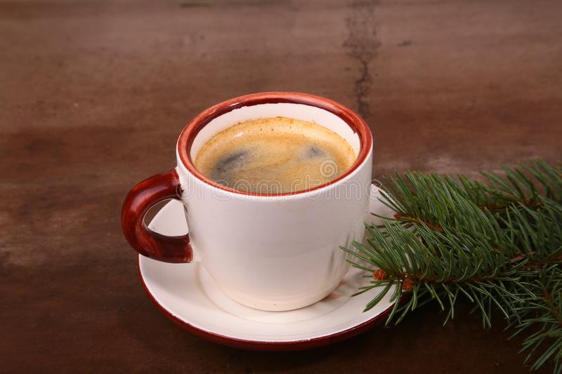 Good morning or Have a nice day Merry Christmas .Cup of coffee with cookies and fresh fir or pine branch.  royalty free stock photos
