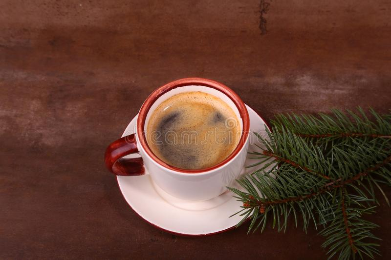 Good morning or Have a nice day Merry Christmas .Cup of coffee with cookies and fresh fir or pine branch.  stock photo