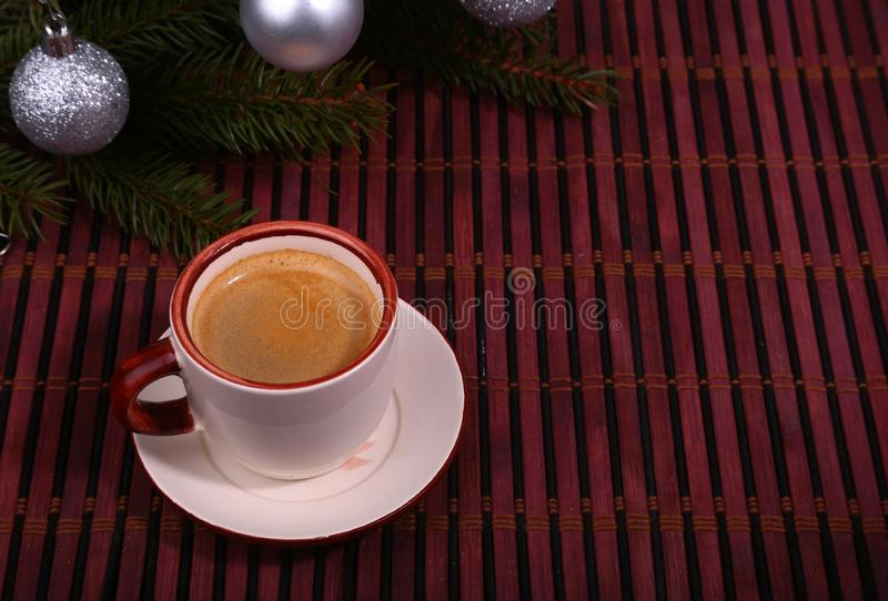 Good morning or Have a nice day Merry Christmas .Cup of coffee with cookies and fresh fir or pine branch.  stock images