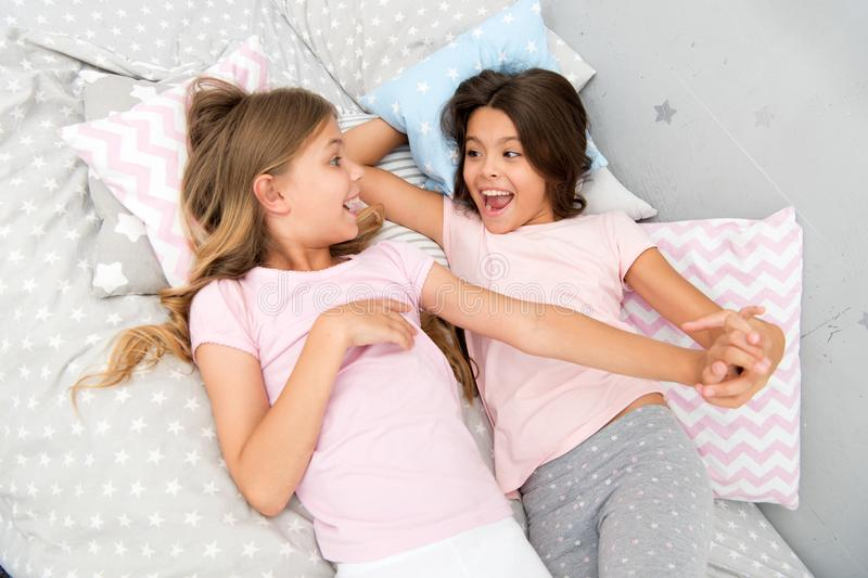 Good morning and healthy sleep. little girls say good morning to each other. little girls in bed after healthy sleep. stock image