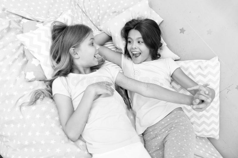 Good morning and healthy sleep. little girls say good morning to each other. little girls in bed after healthy sleep. Good morning. little girls say good royalty free stock image