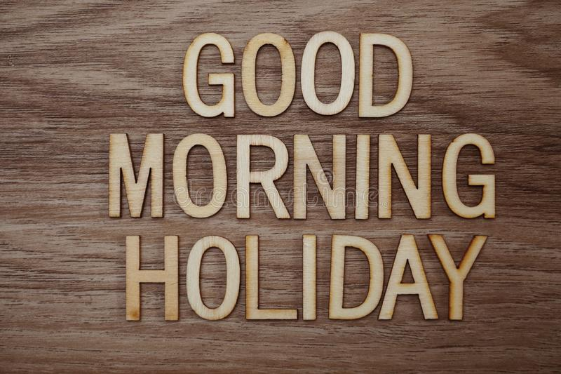 Good Morning Holiday text message on wooden background. Top view Good Morning Holiday text message on wooden background royalty free stock images