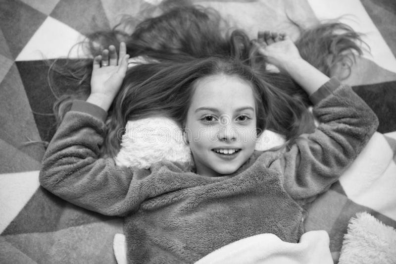 Good morning. I want to play. International childrens day. Childhood happiness. Small girl child ready to sleep. Time to. Relax. Little happy girl in bedroom stock photography