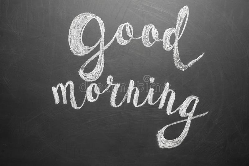 Good morning inscription on a black school board stock images