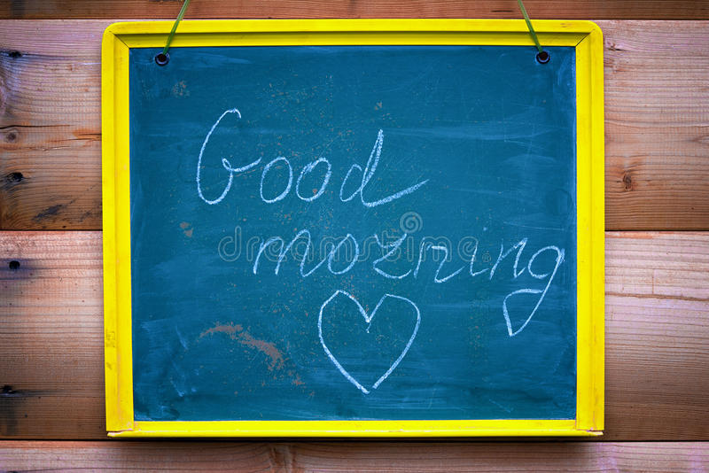 Good morning. Inscription good morning and heart shape on a chalk board royalty free stock images