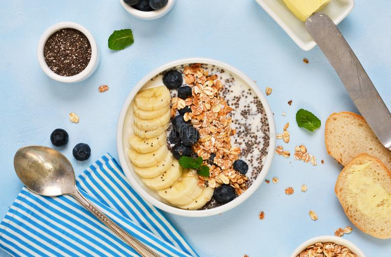 Good morning! A light breakfast of yogurt and granola. With chia seeds, bananas, blueberries and bread toast stock photos