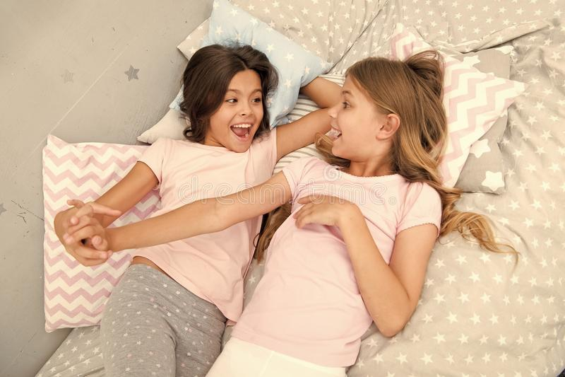 Good morning and healthy sleep. little girls say good morning to each other. little girls in bed after healthy sleep. Good morning. little girls say good stock images