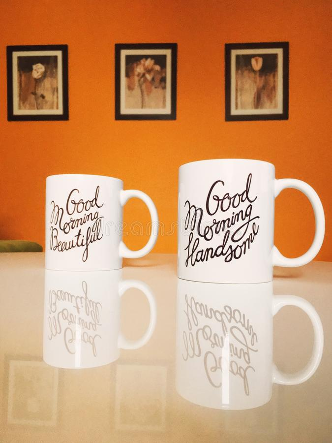 Good morning lovers!. Good Morning Handsome and Beautiful lovely couple mugs stock images