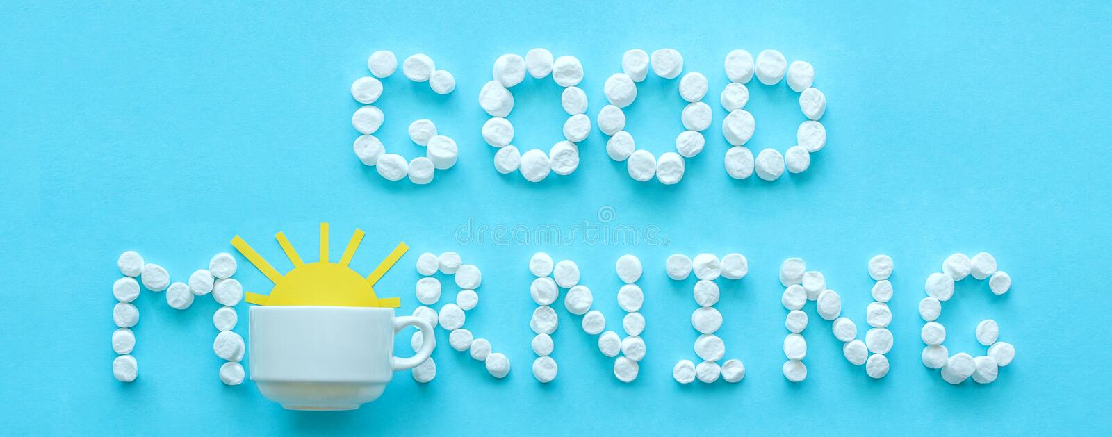 Good morning from marshmallow and coffee cup with rising sun stock photos