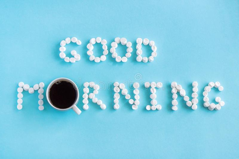 Good Morning from marshmallow and cup of coffee. Concept. Text `Good Morning` from marshmallow and cup of coffee on blue background. Concept stock images