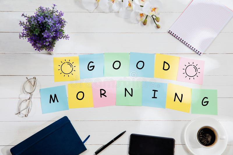 GOOD MORNING. Message at colorful note papers on a desk background. royalty free stock images