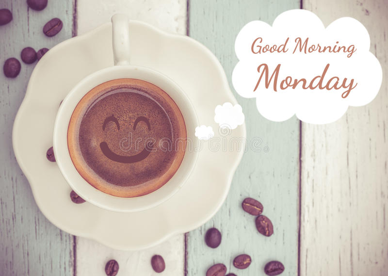 Good Morning Monday with coffee cup. Good Morning Monday with smile coffee cup on table stock image