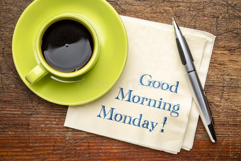 Good Morning Monday on napkin. Good Morning Monday - handwriting on a napkin with a cup of coffee stock photo