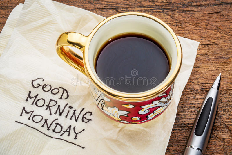 Good morning, Monday on napkin. Good morning, Monday - handwriting on a napkin with a cup of coffee royalty free stock images