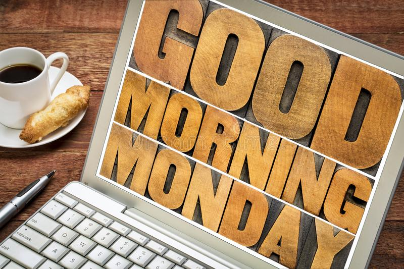 Good Morning Monday on tablet. Good Morning Monday word abstract - text in vintage letterpress wood type printing blocks on a laptop screen with a cup of coffee royalty free stock image