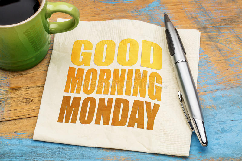 Good Morning Monday. Word abstract on a napkin with a cup of coffee stock photos