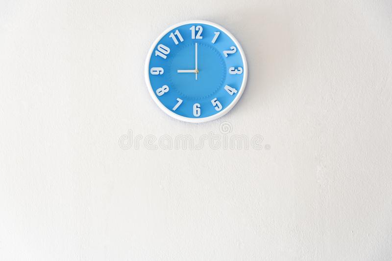 Good morning or night time with 9:00 clock on white concrete wall interior background with copy space, message board concept. Goo stock photography