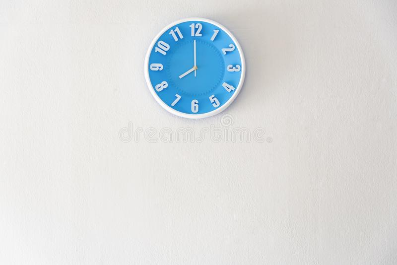 Good morning or night time with 8:00 clock on white concrete wall interior background with copy space, message board concept. Goo. D morning is the greeting in royalty free stock photos