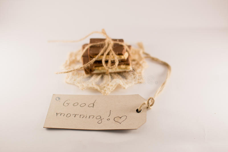 Good morning note, chocolate on a white background stock images