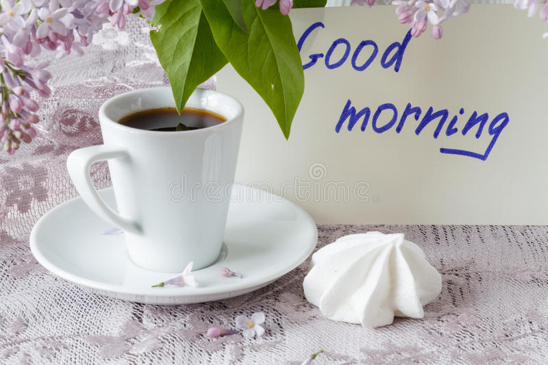 Good Morning note, coffee cup and liliac flowers stock photos