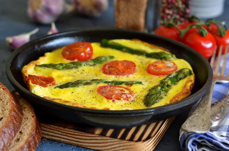 Good morning. Omelet with asparagus and tomatoes for breakfast. With toast and coffee on a blue background royalty free stock photos