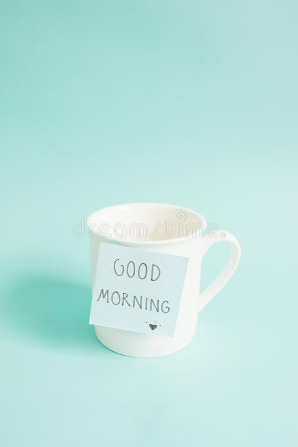 Good morning. On paper note with cup of coffee cup. Side light stock photo