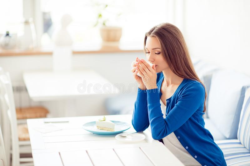 Good morning! Portrait of charming dreamy young girl drinking co stock photography