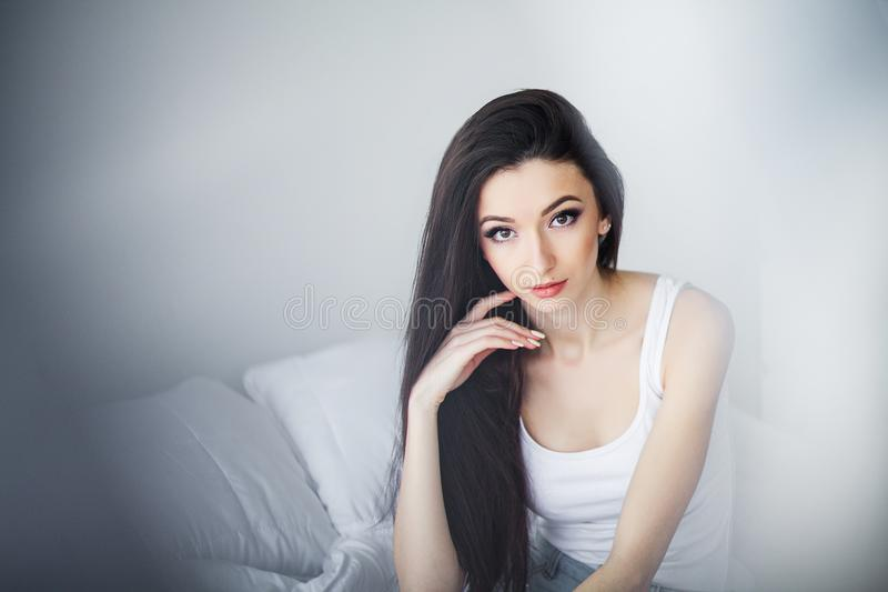 Good morning. Portrait of a smiling pretty young brunette woman stock photos