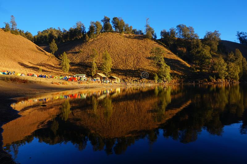 Good Morning from Ranu Kumbolo. Beautiful and perfect reflection of Ranu Kumbolo in the morning. This 2,400 masl lake is favorite campsite for most climbers in stock images