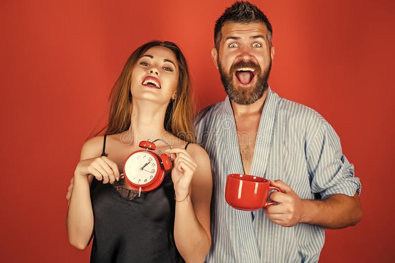 Good morning. Refreshment and energy, time. Men and girl with mulled wine on red. Perfect morning with coffee. couple in love drink morning coffee or tea royalty free stock image