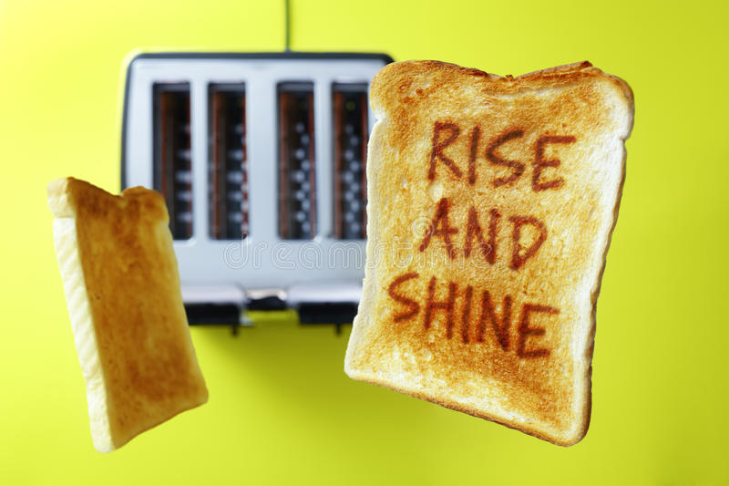 Good morning rise and shine toasted bread. Good morning rise and shine on flying toast or toasted bread popping up from the toaster royalty free stock image