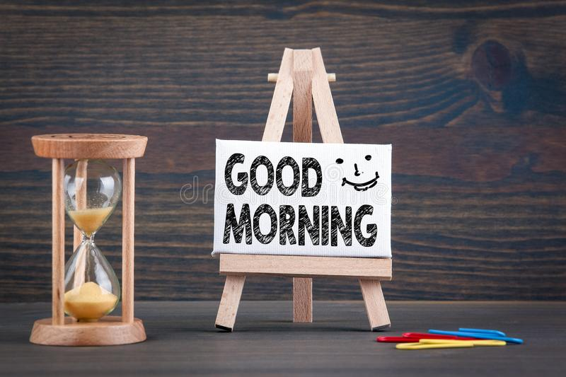 Good morning. Sandglass, hourglass or egg timer on wooden table royalty free stock photos