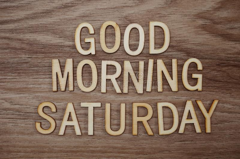 Good Morning Saturday text message on wooden background. Top view Good Morning Saturday text message on wooden background stock photography