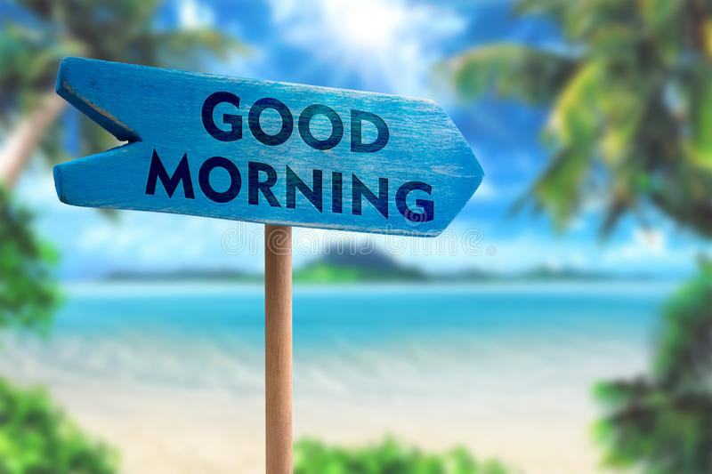 Good morning sign board arrow. On beach with sunshine background stock images
