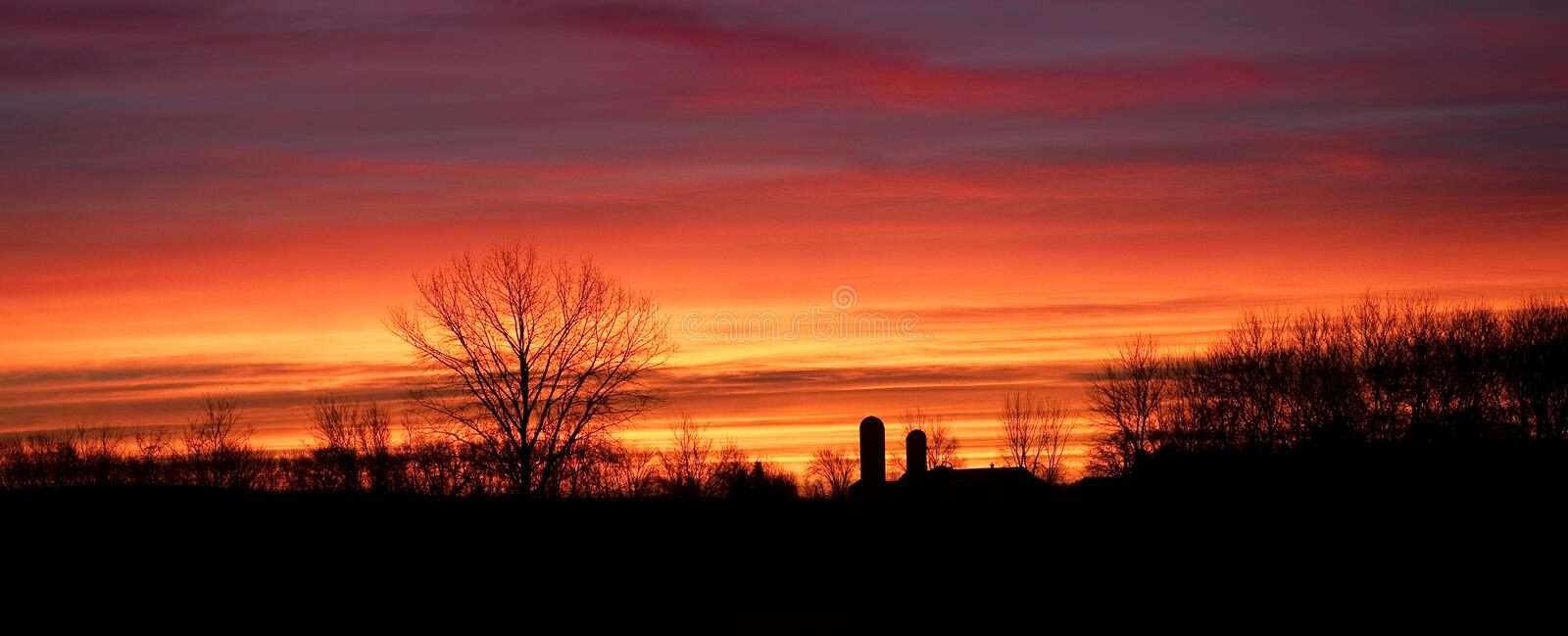 A good morning silhouette sunrise. A good morning sunrise silhouette of a small farm in Minnesota royalty free stock photo