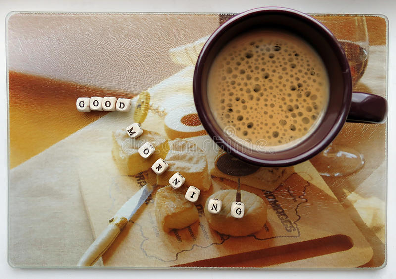 Good morning! - Small wooden cubes and coffee cup. On a light background royalty free stock photography