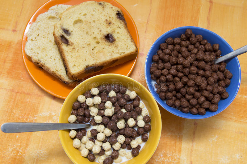 Good morning. A good morning start meal; cereals and sweet bread royalty free stock photography