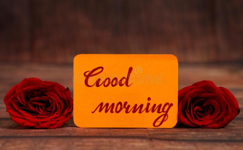 Good Morning text with red roses. royalty free stock photo
