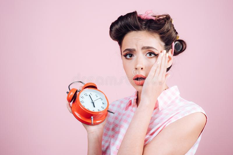 Good morning. time management. pinup girl with fashion hair. retro woman with alarm clock. Time. pin up woman with. Trendy makeup. sleepy tired girl in vintage stock images