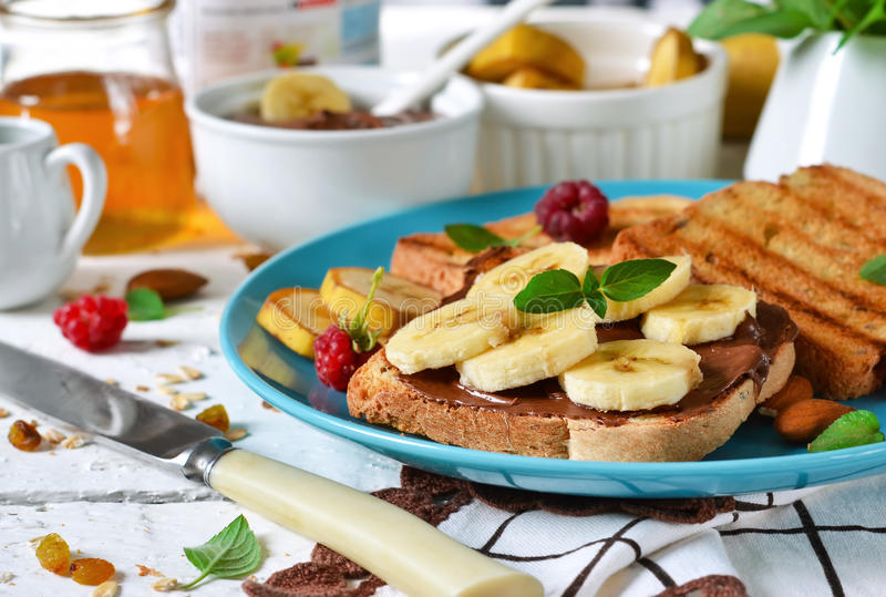 Good morning - toast with walnut, chocolate paste stock images