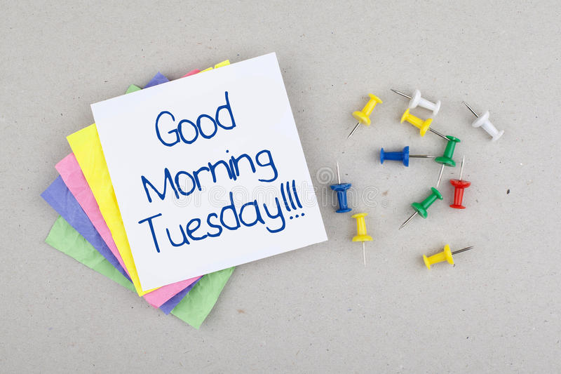 Good Morning Tuesday Note. And colorful pins stock photography