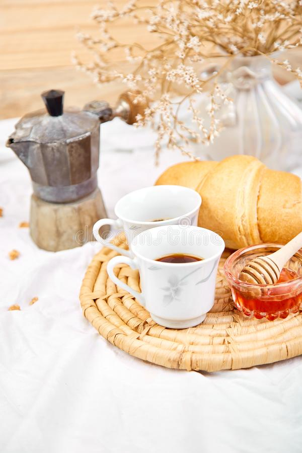 Good morning. Two cup of coffee with croissant and jam. Breakfast on white bed sheets from above. Top view. Flat lay. Copy space. Romantic breakfast stock photos