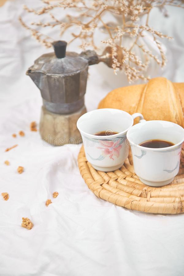 Good morning. Two cup of coffee with croissant and jam. Breakfast on white bed sheets from above. Top view. Flat lay. Copy space. Romantic breakfast stock photography
