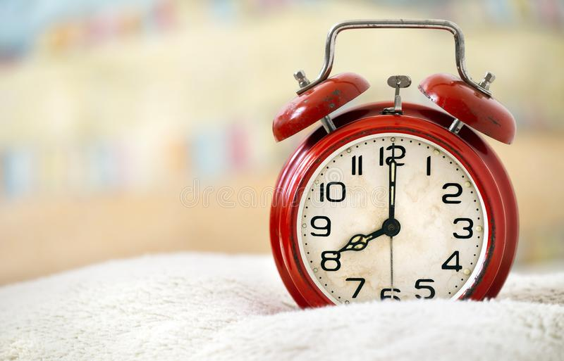 Good morning, wake up, awakening concept. Retro red alarm clock in the bed - web banner with copy space royalty free stock photography